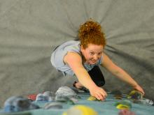 A female student on a climbing wall